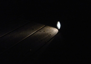 flashlight in darkness